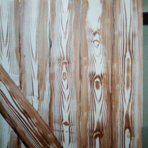 Muurschildering van een houten deur